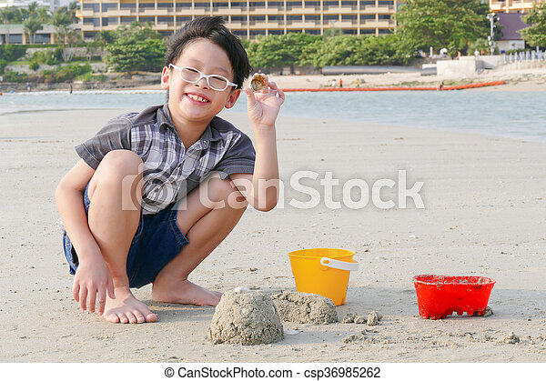 Young boy playing sand - csp36985262