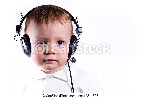 young boy wearing telephone headset - csp10811538