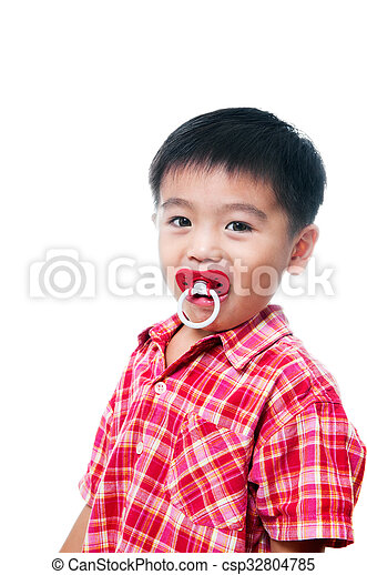 Young boy with pacifier in mouth - csp32804785
