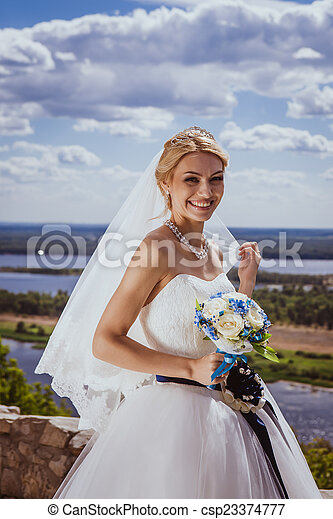 Young bride in white wedding dress - csp23374777