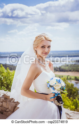 Young bride in white wedding dress - csp23374819