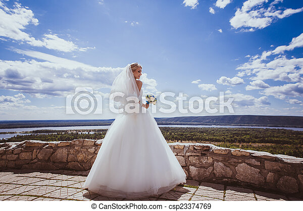 Young bride in white wedding dress - csp23374769