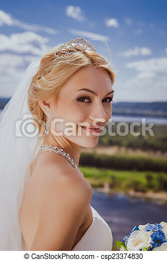 Young bride in white wedding dress - csp23374830