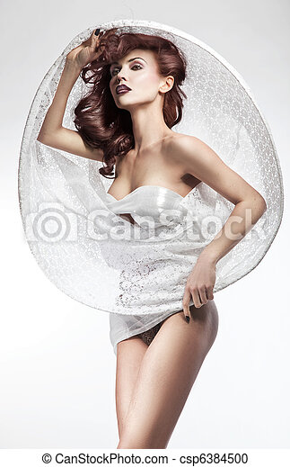 Young brunette beauty posing - csp6384500