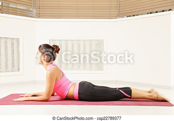 young brunette exercising cobra pose young brunette