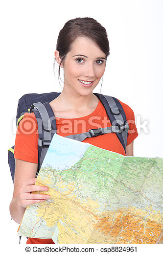 Young brunette holding map - csp8824961