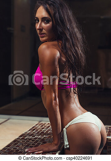 Young brunette woman in the swimming pool. - csp40224691