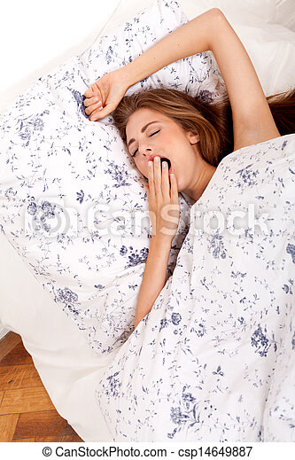 young brunette woman lying in bed sleeping morning  - csp14649887