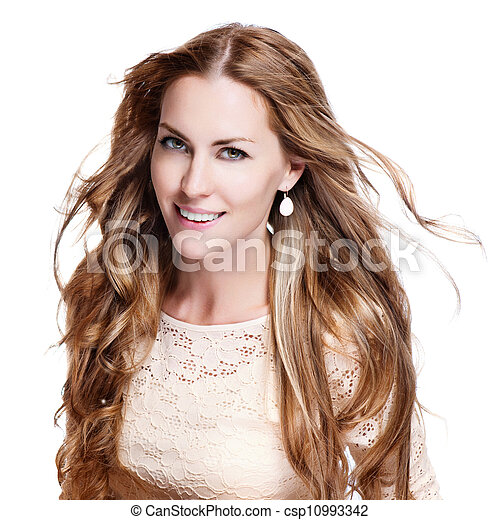 young brunette woman with long flying hair, studio shot - csp10993342