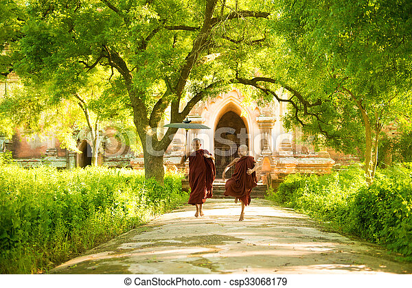 Young Buddhist novice monks running - csp33068179