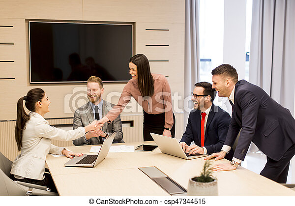 Young business people have meeting in a modern office - csp47344515