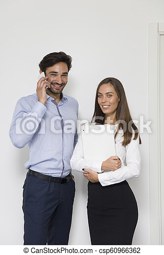 Young business people in modern office - csp60966362