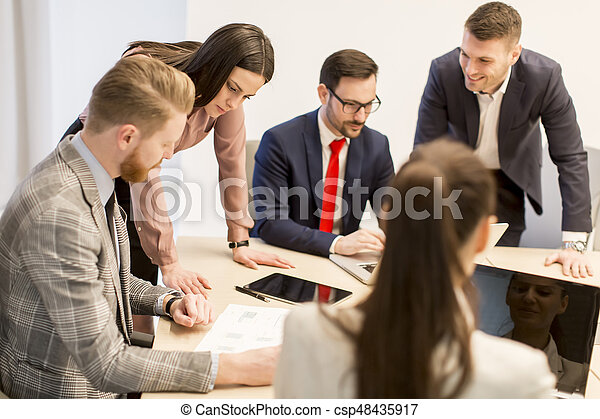 Young business people work in a team in a modern office - csp48435917