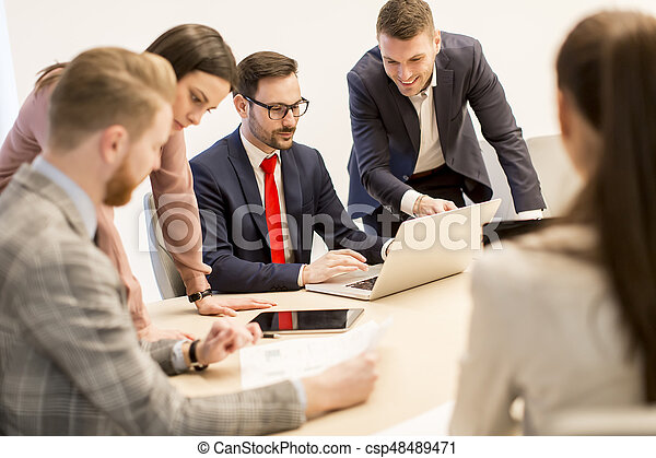 Young business people work in a team in a modern office - csp48489471