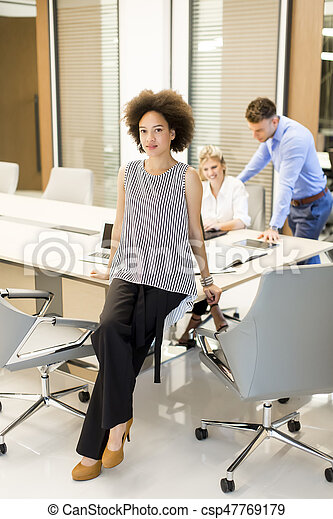 Young business people working in a modern office - csp47769179