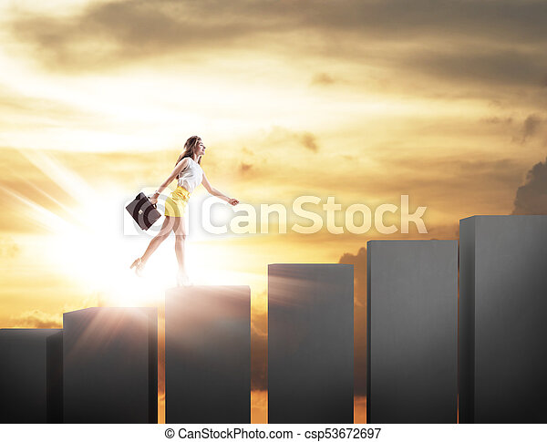 Young business woman climbs up on cubes staircase. - csp53672697