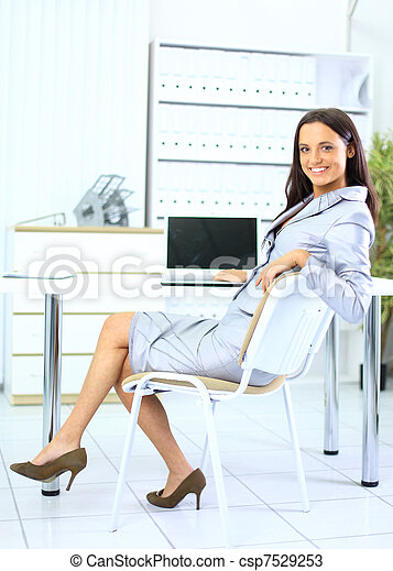 Young business woman in office - csp7529253