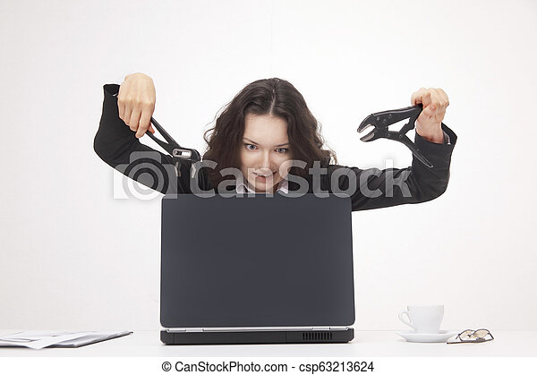 young business woman smashing a laptop. isolated on white. - csp63213624
