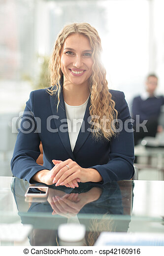 Young business woman standing with her collegues in background a - csp42160916