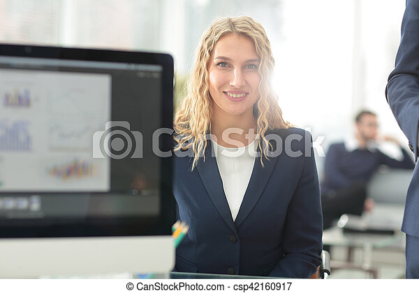 Young business woman standing with her collegues in background a - csp42160917