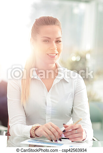 Young business woman standing with her collegues in background a - csp42563934