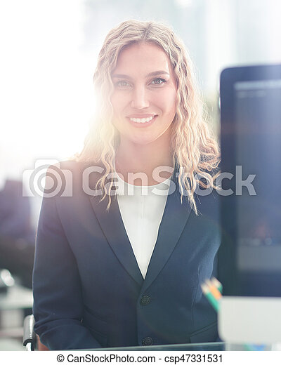 Young business woman standing with her collegues in background a - csp47331531