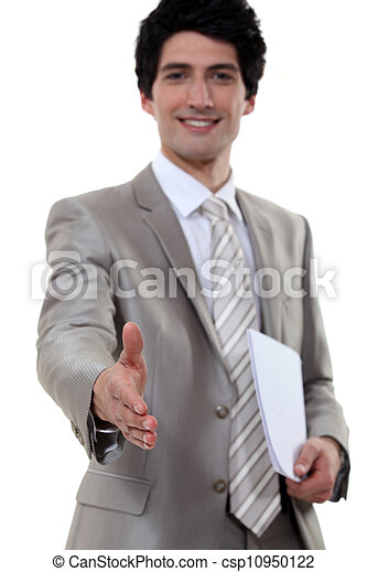 young businessman all smiles shaking hands with invisible business partner - csp10950122