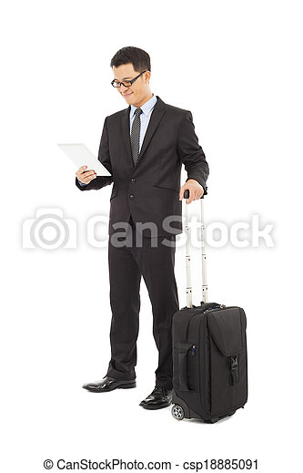 Young businessman holding a tablet  with briefcase  - csp18885091
