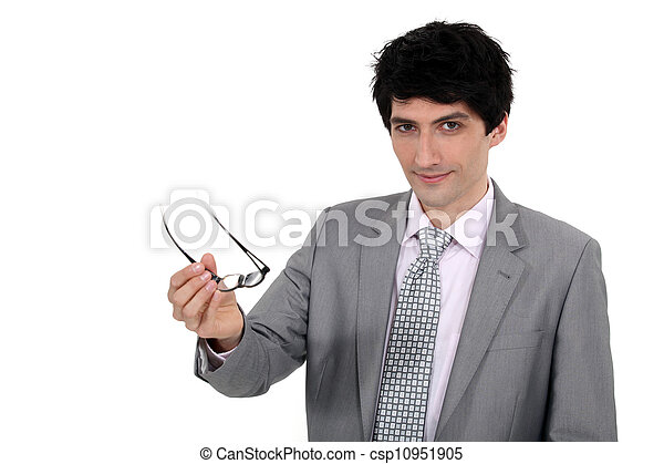 Young businessman holding his eyeglasses - csp10951905