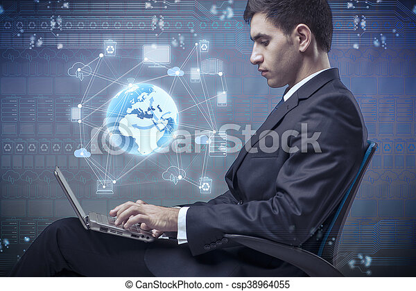 Young businessman in global computing concept - csp38964055