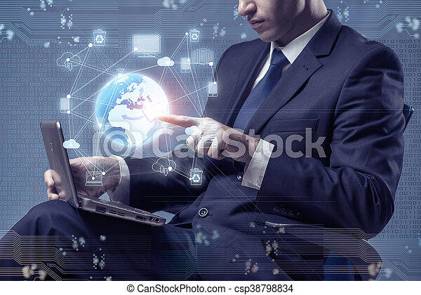 Young businessman in global computing concept - csp38798834