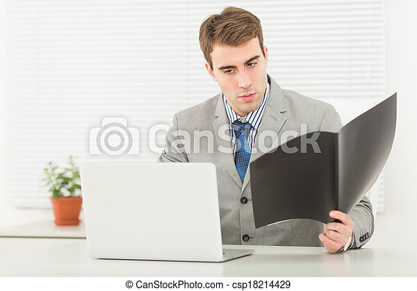 Young businessman in office - csp18214429