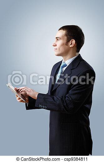 Young businessman making presentation - csp9384811