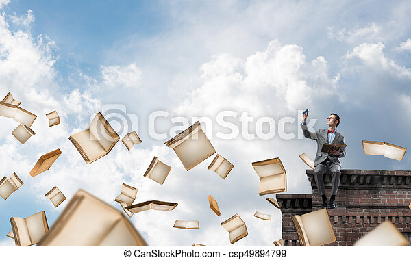 Young businessman or student studying the science and books flying around - csp49894799
