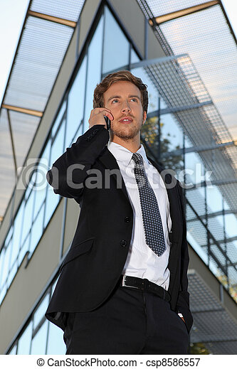 Young businessman outside a modern office building - csp8586557