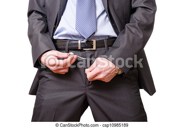 Young businessman pulling out a usb cable out of his pants. - csp10985189