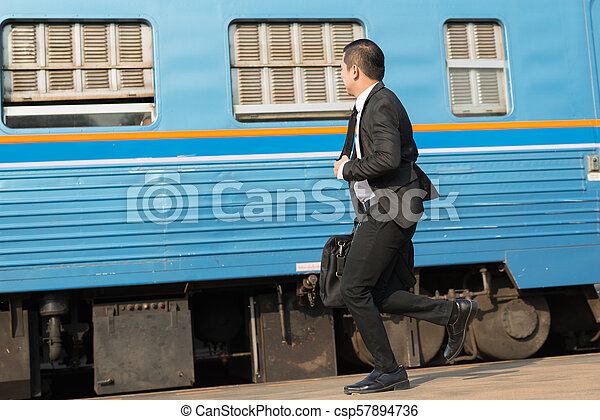 Young Businessman Running In The Train