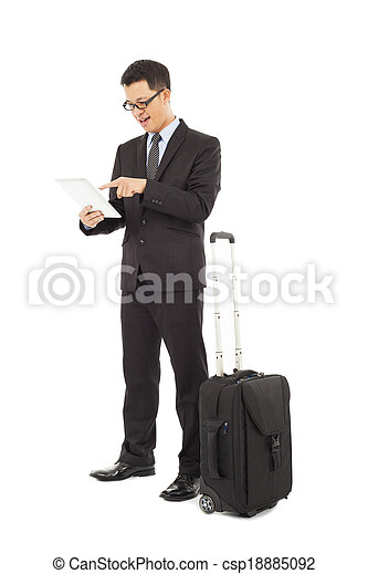 Young businessman using a tablet  with briefcase  - csp18885092