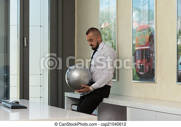 Young Businessman With Globe - csp21040612