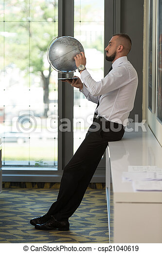 Young Businessman With Globe - csp21040619
