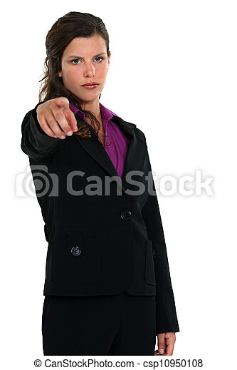 young businesswoman pointing at someone in front of her - csp10950108