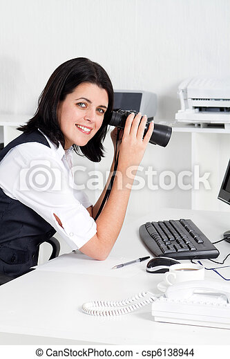 young businesswoman with binoculars - csp6138944