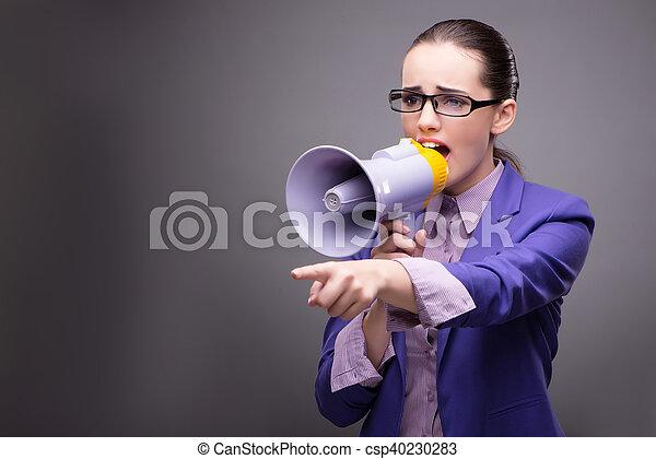 Young businesswoman yelling through loudspeaker - csp40230283