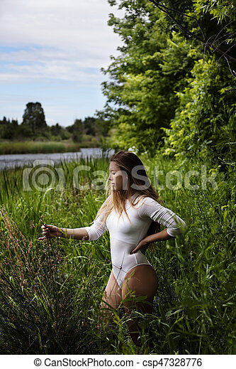 Young Caucasian Teen Girl Outdoors In White Leotards - csp47328776