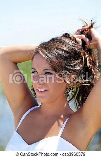 Young caucasian teen woman outdoor portrait white dress - csp3960579