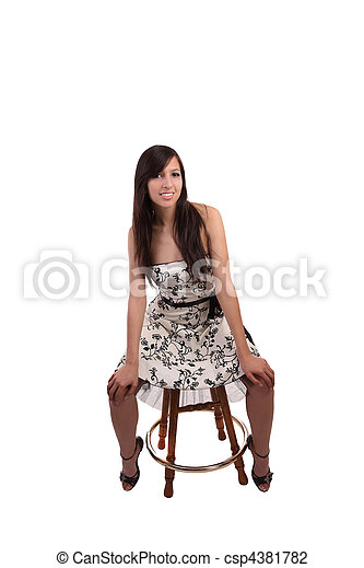 Young caucasian woman in dress on stool - csp4381782