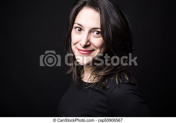 young caucasian woman portrait on black background - csp50906567