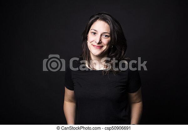 young caucasian woman portrait on black background - csp50906691