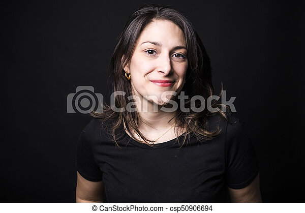 young caucasian woman portrait on black background - csp50906694