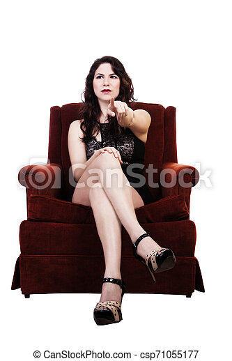 Young Caucasian Woman Sitting In Chair Pointing - csp71055177
